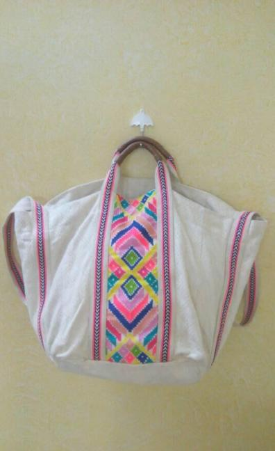 White bag with colourful beautiful design and extra space