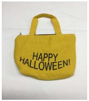 Happy halloween written yellow jute bags