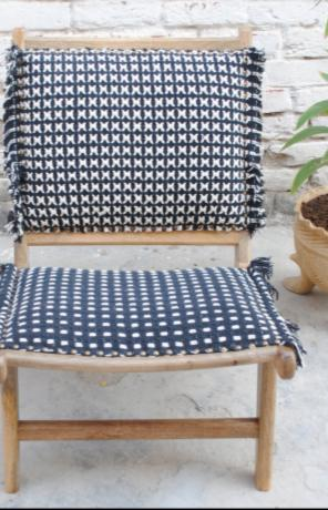 low wooden folding chair, black and white upholstery
