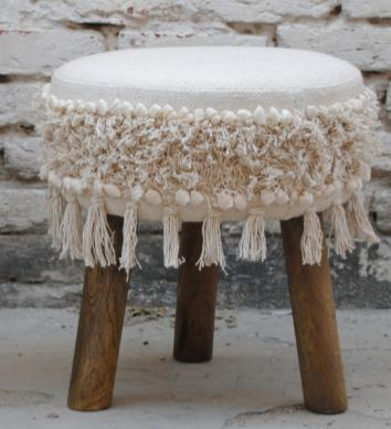Round fabric footrest, white with lace-like fabric decoration on the edges, boheme inspiration